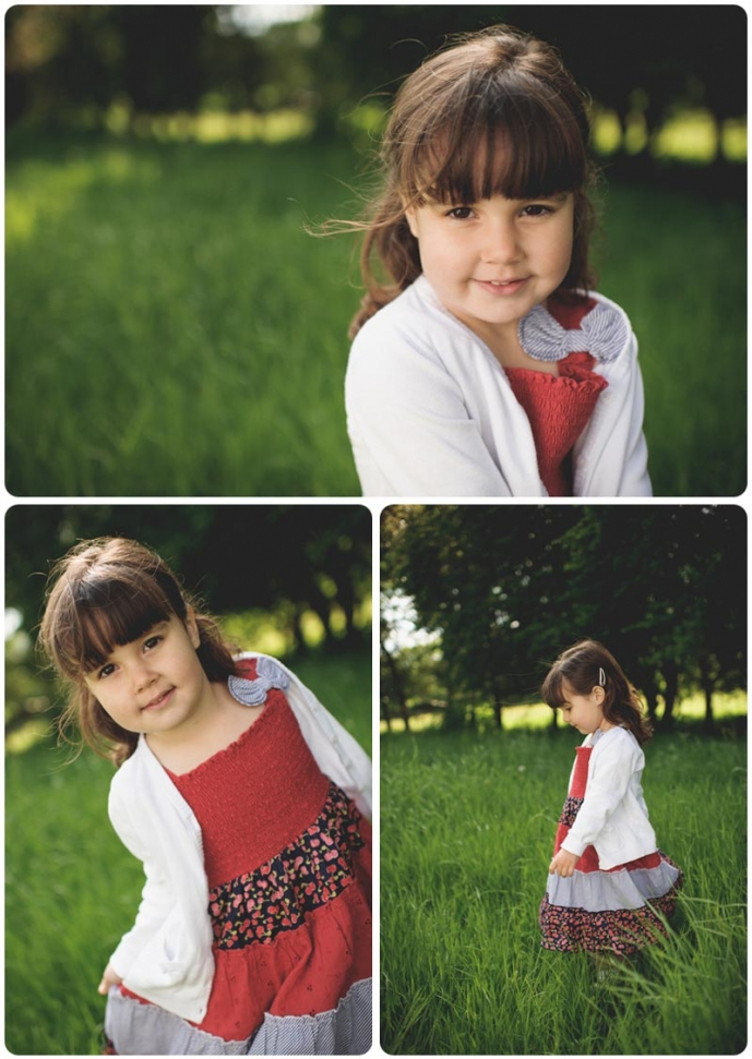 Child poses in her red dress for family photography session