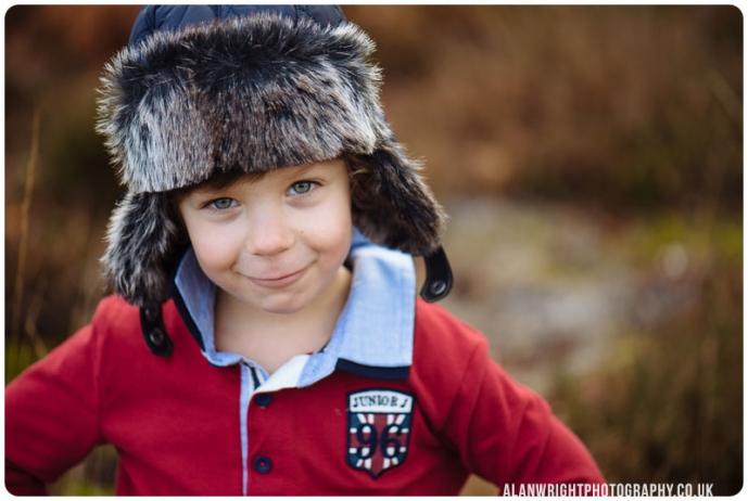 A portrait of a boy wearing a hat