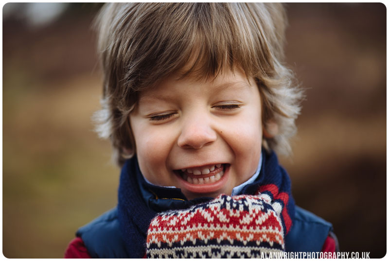 child giggling when photographed