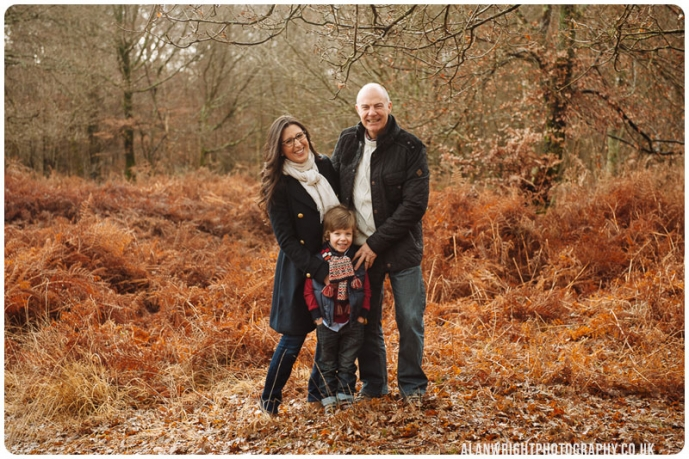 Family pose for a professional outdoor photograph