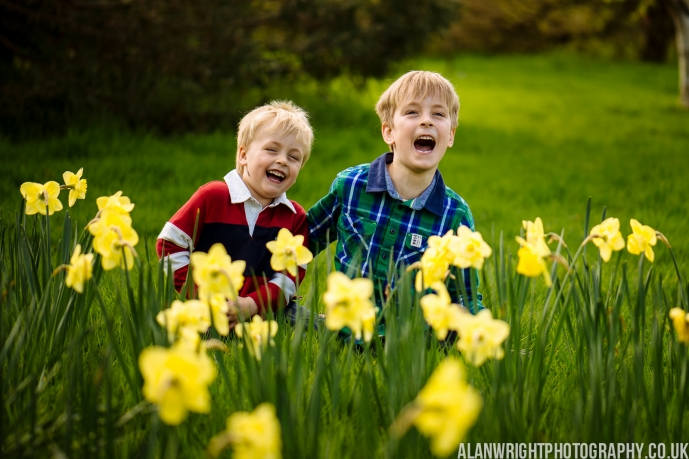 Children playing amongst the daffodils