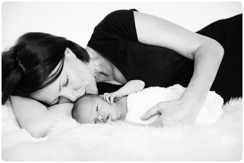 A mother cuddles her newborn son