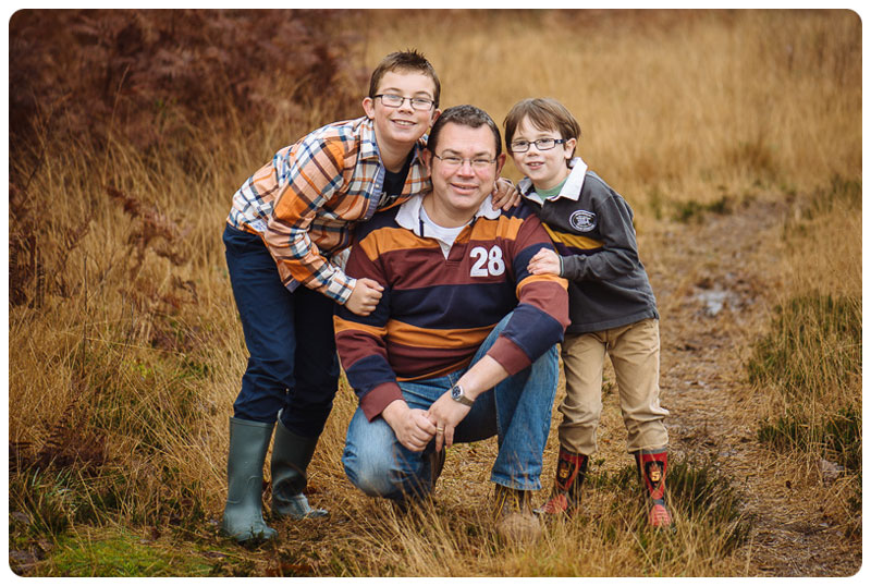 Dad and boys pose for family photograph