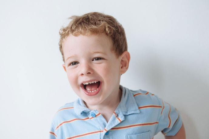 natural expression of boy laughing