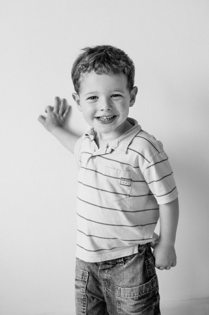 Boy poses for professional portrait