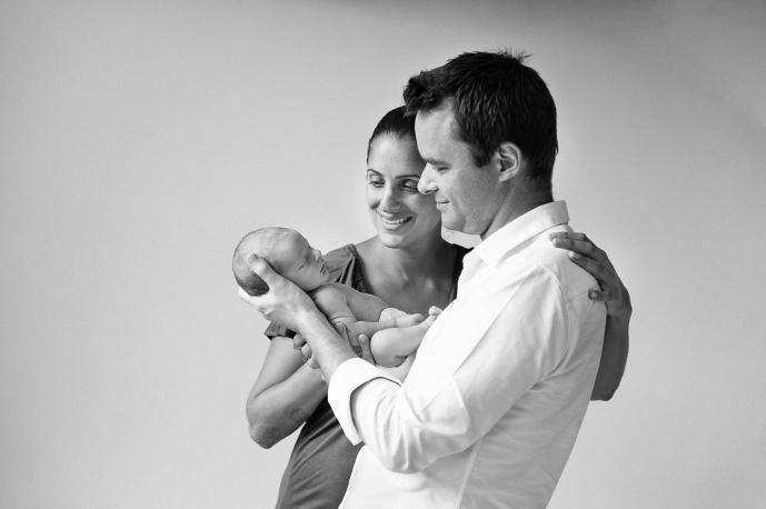 Proud Mum & Dad admire their newborn baby