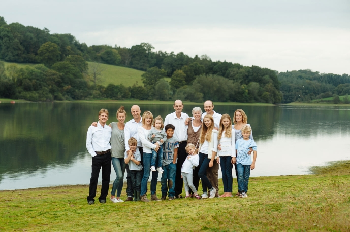 Extended family pose for family photograph near Ardingly Reservoir