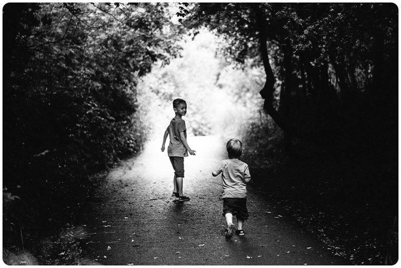 Two Boys running off to have an explore of the park