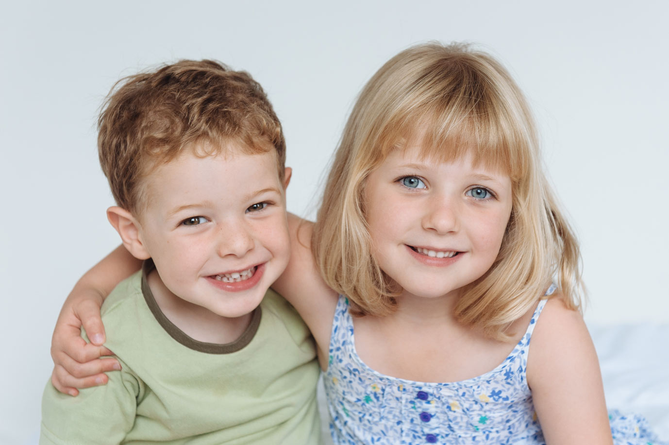 Young siblings pose for portrait