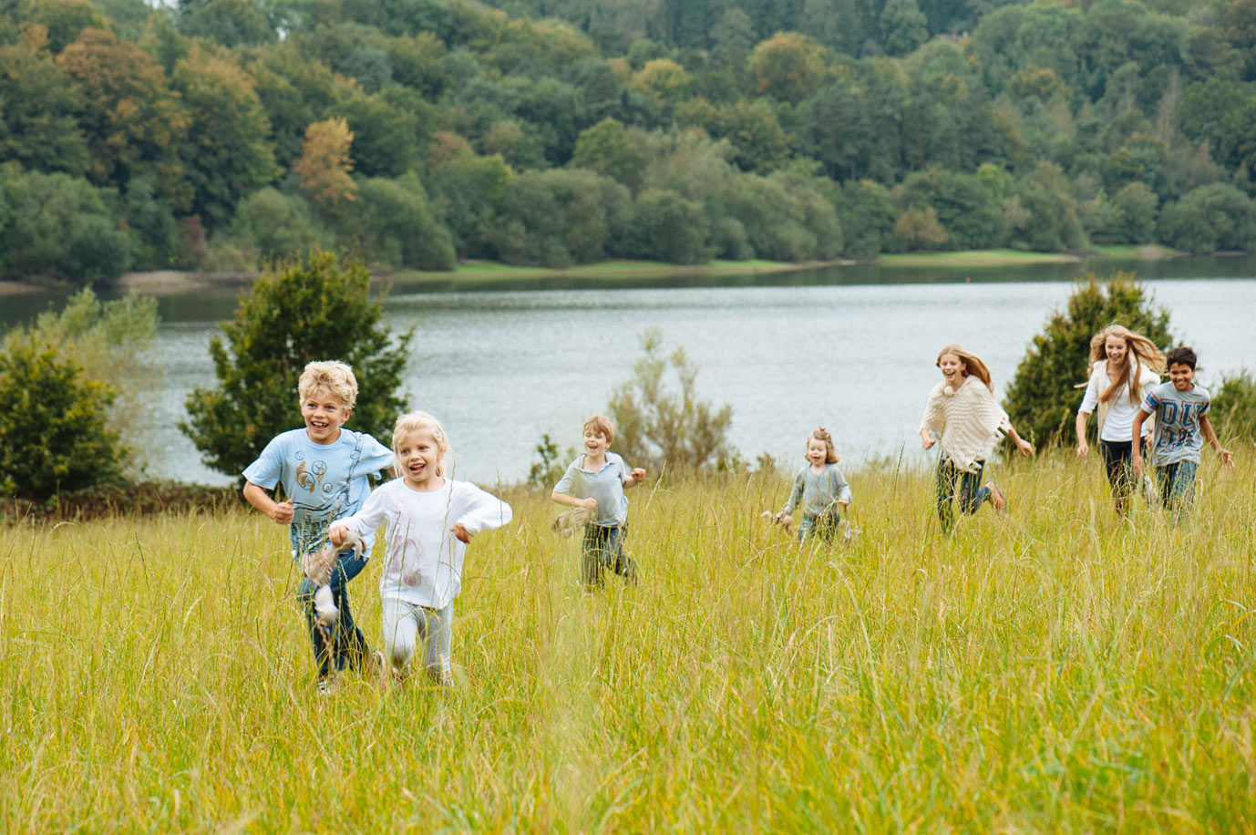 children running though meadow
