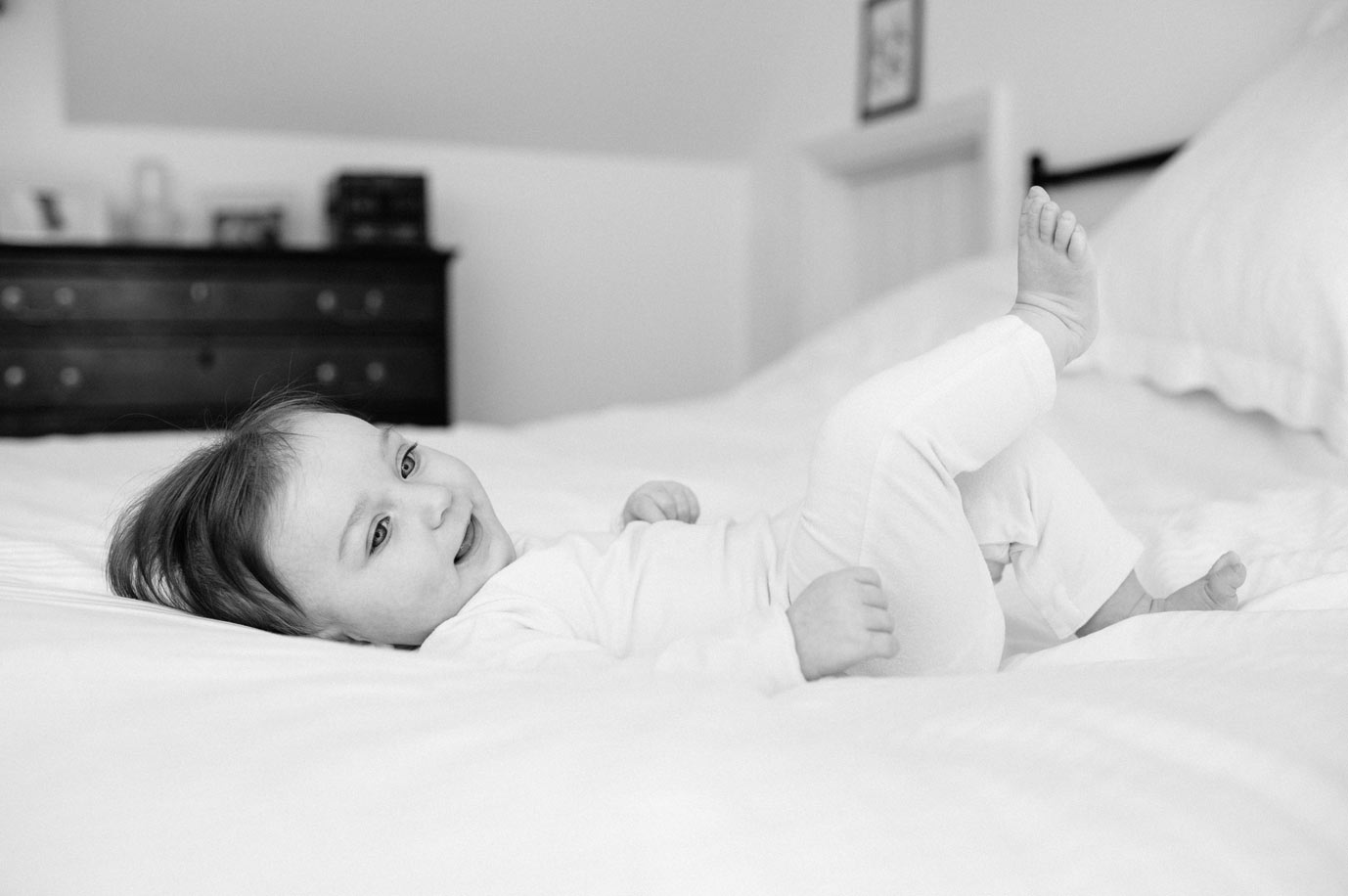 Baby relaxes on the bed