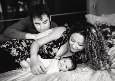 Parents on Bed with Newborn